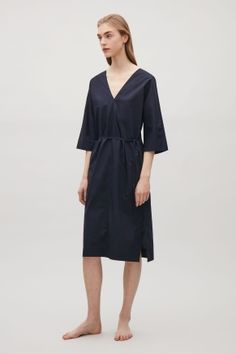 Designed with a deep v-neck front and back, this kaftan style dress is made from a lightweight cotton. A straight fit, it has a narrow drawstring waist, ¾ kimono sleeves and subtle in-seam pockets. Kaftan Style, Work Wardrobe, Knit Dress, Summer Outfits, Fashion Dresses, Cold Shoulder Dress, Dresses For Work, Cos, Stylish