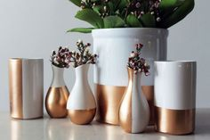 Upgrade plain white bud vases, ceramic tumblers, and utensil holders, sectioning off each container with painter's tape.
