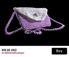Crochet Handbag, Leather Interior, Handmade Purse, Lilac and White This simple lilac and white crocheted handbag is perfect for the woman on the go. The leather interior has an extra side pocket to hold cards or small items, ensuring that they don't fall out! The pearlized button adds a touch of charm and elegance to this fantastic purse. Great way to accentuate any part of your wardrobe and/or just have for an every day splash of style. The beautiful strap is hand spun from several strands…