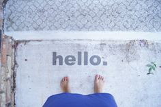Stencil a message. Eschew the typical welcome mat in favor of something more creative: words stenciled directly on the ground. Paint words on the steps, front walk or porch floor for a personal touch.