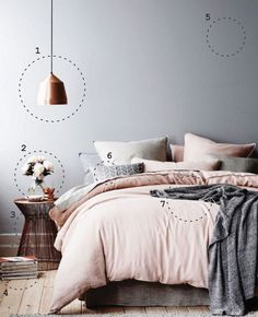 "1. Metal lighting in warm copper/rose gold instead of silver/yellow gold. Never use ""daylight"" bulbs. 2. Fresh flowers (soft bloom - peonies/ranunculus) to add life to pared-down space. 3.: Minimal accents & simple forms—even though the side table is metal, it feels light & airy because of the hue, simple silhouette, & negative space between the metal grates. 4. Casually place accessories instead of creating a rigid system of organization. 5. Choose soft neutrals - F&B Cornforth White."
