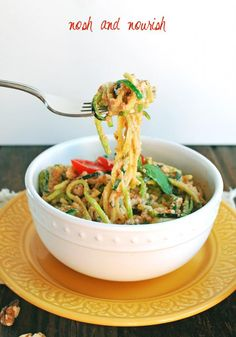 Creamy Red Pepper Alfredo over Zoodles (zucchini noodles) via Nosh and Nourish #recipe #vegan