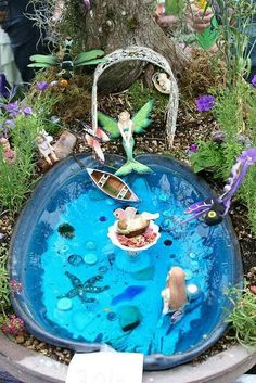 A mermaid pool and garden in miniature