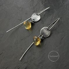 Earrings are totally made of oxidized silver 925 and citrine.  Dimensions: Stones: approx. 0.35 (9 mm) Earrings total length: Hooks type - 1.57 inches (4 cm) Studs type - 0.9 inches (2.3cm)  Single earrings weight: 1,6g  Here you can see our archival works from this collection (its possible to make them again for special request): https://web.facebook.com/formood/photos/a.159142094211694.32464.118654118260492/330782077047694/?type=3&theater  Ready to ship  We pack all the items in corporate…