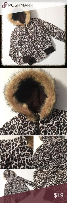 """Dollhouse Leopard Print Zipper Jacket w/ Fur Hood This is an awesome jacket with spectacular details. Fur lined hood, pockets with button details, full zip front. Chest measures 18"""" across from armpit to armpit. 21"""" long. Sleeves are 24"""" long. In excellent condition. Cotton/polyester/faux fur. Dollhouse Jackets & Coats"""