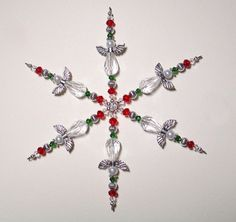 Beaded Snowflake Ornament ~ Christmas Ornament ~ Suncatcher ~ White, Red & Green Guardian Angel Ornament ~ Crystal Ornament ~ Snowflake by ItsaColorfulLife on Etsy https://www.etsy.com/listing/237027190/beaded-snowflake-ornament-christmas