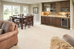 A lower level family room with a kitchenette.  Perfect for entertaining.