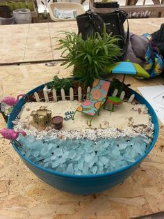 Beach gardens are awesome! Sea glass makes awesome waves with mini seashells and beach accessories. So fun! Love the sandals, sand castle, and pail!