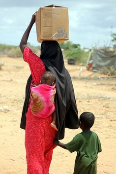 Mother and Child in Kenya receive food from Feed my Starving Children.