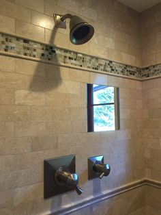 Ron's in-wall shaving shower mirror ; it's heated, so it's no-fog. He'd like this again!