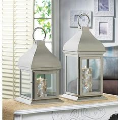 """All it takes is a beautiful candle inside to make your whole room glow or get creative and use it as a terrarium full of decorative baubles. Small measures 8"""" x 8"""" x 13 1/4"""" high; 16 1/4"""" high with handle. Large measures 8"""" x 8"""" x 16 1/4"""" high; 19 1/4"""" ..."""