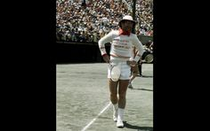 """An avid tennis player, Elton John often plays in celebrity tournaments and promotes the sport. His song """"Philadelphia Freedom"""" is a tribute to his friend Billie Jean King and her tennis team. Here he is playing tennis in New York in 1975."""