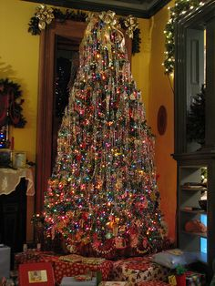 Growing up, our tree always had blinking colored lights and dripping in tinsel.