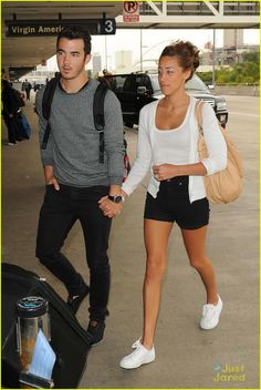 kevin danielle jonas lax. She looks like she wants to kill him. Someone please feed them! They are soooo skinny!