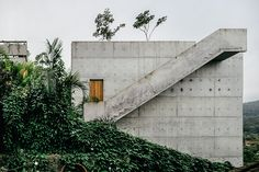 Set on a hillside overlooking the Brazilian coastline, the Ubatuba House raises above the grade to allow for its simple geometric shape. The main house is comprised of a 10m by 10m by 6m concrete box, with the open bottom...