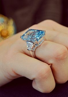 Blue is the color of trust, honesty, loyalty, reliability and responsibility. Perfect Emerald cut march birth stone engagement ring by Ascot Diamonds