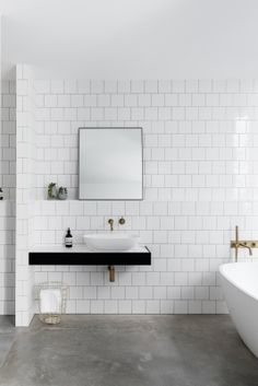 Leveson Street Residence | minimalistic, clean, white tile walls, neutrals bathroom Décor Antique, Basement Bathroom, Bathroom Bin, Bathroom Remodeling, Bathroom Sets, Bathroom Inspo, Remodeling Ideas, Bathroom Inspiration, Bathroom Vanity Tops