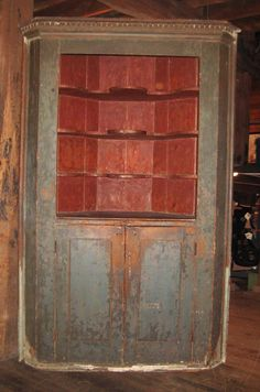 18th Century Corner Cupboard. That would look amazing in dark colors.