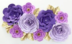 large paper wall flowers in lilac and purple with gold accents for nursery wall decor