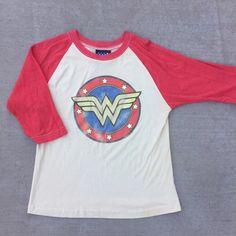 Wonder Woman Baseball Tee Raglan sleeved baseball tee with Wonder Woman screen. Stain at body/armhole seam (see pic) but not noticeable. Junk Food Tops Tees - Short Sleeve