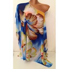Kaftan copricostume in fantasia floreale nei colori del marrone, corallo, bianco, giallo, blu e verde  Si può usare anche come semplice t-shirt da indossare su un jeans o un pantalone bianco.
