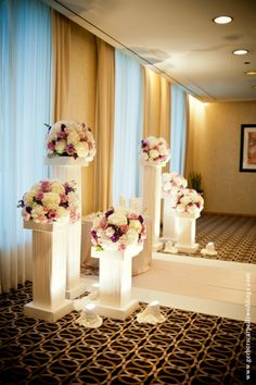 Karen and Rob had a wedding in the sky at The Mid-America Club on a Saturday evening in July.  The light touches of purple and lavender really played up the space and highlighted the magnificent views of the Club.  The bouquet featured picasso calla lilies, which were stunning alongside her gorgeous gown. Vendors/Partners: Orange2 Photo, The Mid-America Club …