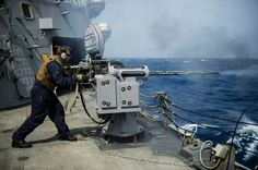 25mm being fired during a live-fire exercise in the Gulf of Aden aboard the USS Roosevelt (DDG 80) June 24, 2014