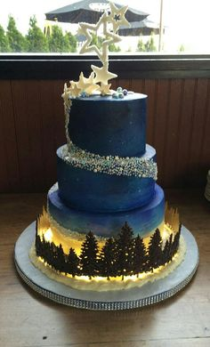 wedding cakes blue Top 5 Early Summer Navy Blue Wedding Ideas to Stand You Out---navy blue and gold wedding cake with woodland tree decors Royal Blue Wedding Cakes, Navy Blue And Gold Wedding, Wedding Cakes With Cupcakes, Elegant Wedding Cakes, Gold Wedding Cakes, Gothic Wedding Cake, Creative Wedding Cakes, Red Gold, Wedding Cake Photos
