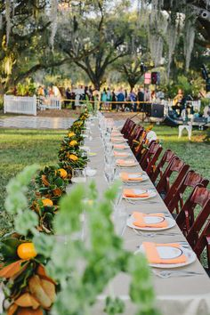 head table with a citrus + magnolia garland | Sunglow Photography