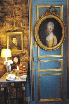 Great look: painted door with gold trim and fine antique portrait in frame, hanging on it.