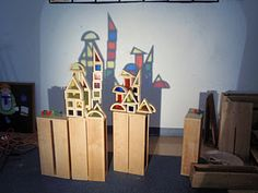 Block Center- Use overhead projector or other light source to allow children to play with light and shadows.