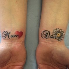 Script tattoo on wrists with daisy and heart by Travis Allen at twisted tattoo Yaxley Www.twistedtattoo.co.uk