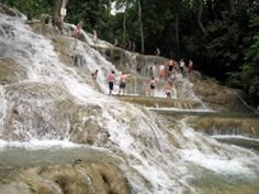 Dunns River Falls - located in Ocho Rios a few miles from the city center. The Dunns River Falls cascade over smooth lime stone rocks, through the tropical rain forest all the way to the white sandy beach below. You can climb up the water falls which is 183 meters (600 feet) high.