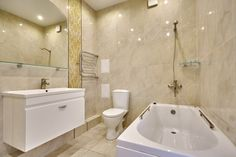 The light colors of the ceramic tiles cover this bathroom for a bright and glossy look