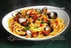 Pasta with clams and Pachino cherry tomatoes
