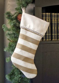 Painted Burlap Stocking: a simple sewing pattern and fun way to customize! Could easily make several of these beauties in an afternoon.