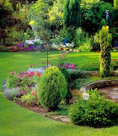 Evergreen shrubs and perennial flowers framed by a lush #lawn. In Birmingham, AL we require irrigation to keep our landscapes looking green and www.BlueSkyRain.com gives awesome service on sprinklers and landscape lighting.