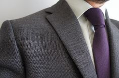 purple tie and gray suit with subtle texture