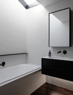 A sleek family bathroom with a Duravit undermount washbasin
