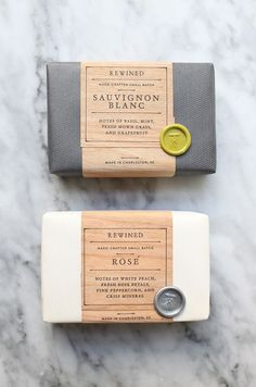 Rewined Soap Packaging. Letterpressed wood veneer wraps with color coded wax seals.