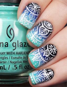 Tribal nail art design on top of a blue gradient theme. Dark and light blue are used for the gradient effect while white polish is used for the tribal designs on top.