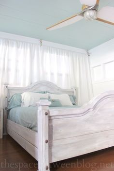 shabby chic master bedroom bed, aqua ceiling and nautical ceiling fan ... love this light and breezy look