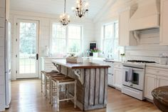 kitchen hood/plank wall/island wood.... what's not to love