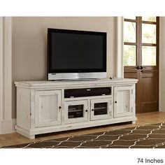 Bring the homey, rustic feel of the country into your room with this distressed white entertainment center. The solid pine construction and worn, white paint veneer gives this entertainment center the More