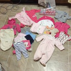 21 piece lot of 3-6 month baby girl clothes Awesome lot of 3-6 month baby girl clothes. Swaddled so/ receiving blankets/ sleepers, onsies, pants.  The 3 pairs of rattle socks, the blue and white pa Ts, and the harvest top are net. Other