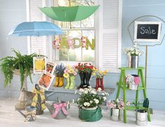 Ideas from smart-retailer.com: Blow-up seed packet images and glue to wood slats Cover chip board or foam core with patterned paper, glue or screw together so that letters overlap and attach a wire hanger