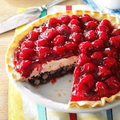 Red, White and Blue Berry Pie- Bright blueberries  raspberries sandwich a cream cheese layer in the pie that's quite festive.