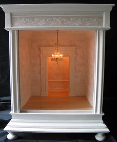 What a lovely Room Box! Like the lit passage at rear. Dressed, would make a very pretty miniature vignette.