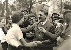 The maiden on the left is looking at Hitler with melting devotion. Many men live their entire lives without ever having a lady look at them like that. For Hitler, this happened hundreds of times every day he was in public. (via putschgirl)