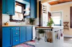 richly painted cabinets. beadboard. great organization for a small space. Kristen & Michelle's Modern Bohemian House Tour | Apartment Therapy